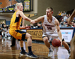 SIOUX FALLS, SD - MARCH 8:  Dylan Phair #10 from Indiana Tech drives by Andreas Jönsson #4 from West Virginia University Tech at the 2018 NAIA DII Men's Basketball Championship at the Sanford Pentagon in Sioux Falls. (Photo by Dave Eggen/Inertia)