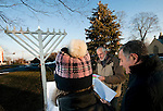 MIDDLEBURY,  CT-122416JS01-- Tom Hungerford, Chaplin at the Westover School, center, sings Hanukkah Blessing with MIddlebury selectman Mike McCormack and his wife Mary Anne McCormack during the annual Menorah lighting on the Green in Middlebury Saturday afternoon. The lighting marks the start of the Jewish holiday of Hanukkah which began on the night of Saturday December 24 and runs until the evening of January 1, 2017. <br />  Jim Shannon Republican American