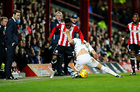 Florian Jozefzoon of Brentford and Gaetano Berardi of Leeds United tussle during the Sky Bet Championship match between Brentford and Leeds United at Griffin Park, London, England on 4 November 2017. Photo by Carlton Myrie.