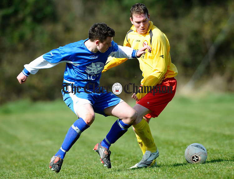Bunratty's Stephen Monaghan and Avenue's Eamon O Reilly in action during their Junior Cup game at Bunratty. Photograph by John Kelly.