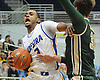 Hempstead, NY - January 22, 2014: Hofstra University No. 3 Zeke Upshaw, left, tries to draw a foul on The College of William & Mary No. 31 Sean Sheldon during the second half of an NCAA men's basketball game at Mack Sports Complex. Upshaw scored a team-high 21 points in Hofstra's 77-60 win. (Photo by James Escher)
