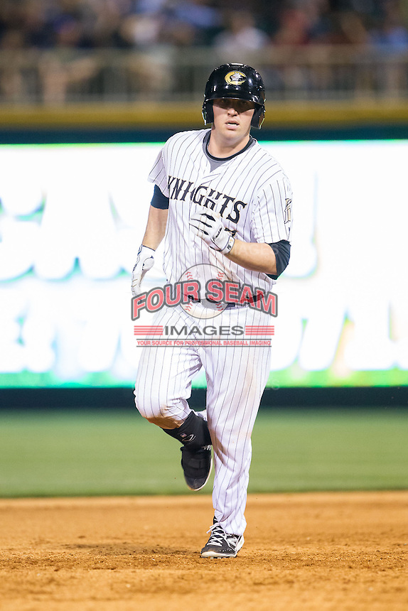 Andy Wilkins (17) of the Charlotte Knights rounds the bases after hitting a home run against the Lehigh Valley IronPigs at BB&T Ballpark on May 8, 2014 in Charlotte, North Carolina.  The IronPigs defeated the Knights 8-6.  (Brian Westerholt/Four Seam Images)