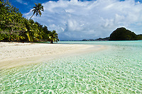 Tropical beach scene with palm trees and crystal clear water, Palua Micronesia. (Photo by Matt Considine - Images of Asia Collection)