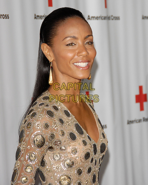 JADA PINKETT SMITH .at the Annual Red Tie Affair hosted by The American Red Cross: Santa Monica Chapter held at Fairmont Miramar Hotel in Santa Monica, California, USA, .April 17th 2010. .portrait headshot hair up dangly earrings gold beige v-neck metallic discs sequined sequin beaded   smiling                                                  .CAP/RKE/DVS.©DVS/RockinExposures/Capital Pictures.