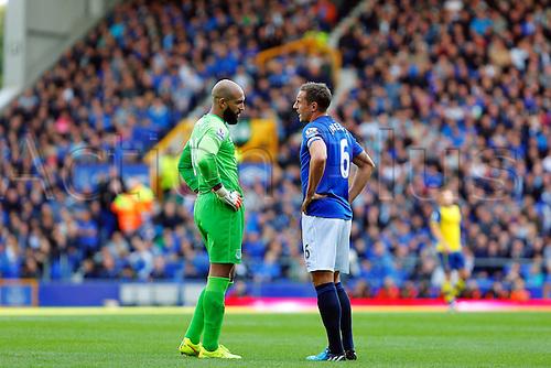 23.08.2014.  Liverpool, England. Premier League. Everton versus Arsenal. Everton goalkeeper Tim Howard and Everton defender Phil Jagielka talk to each other about tactics