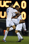 06 December 2014: North Carolina's Omar Holness (JAM) (14) celebrates his goal with Walker Hume (37) and Nick Williams (right). The University of California Los Angeles Bruins hosted the University of North Carolina Tar Heels at Drake Stadium in Los Angeles, California in a 2014 NCAA Division I Men's Soccer Tournament Quarterfinal round match. The game ended in a 3-3 tie after two overtimes. UCLA advanced to the next round by winning the penalty kick shootout 7-6.