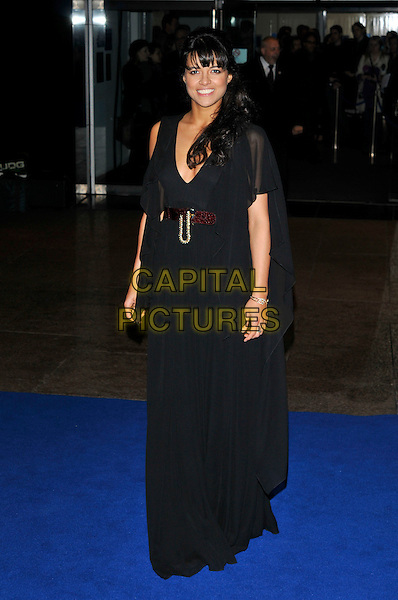 """MICHELLE RODRIGUEZ  .Arrivals - World Premiere of """"Avatar"""",  Odeon Leicester Square, London, England, UK, December 10th, 2009..full length black long maxi dress belt v-neck floaty sleeves .CAP/PL.©Phil Loftus/Capital Pictures."""