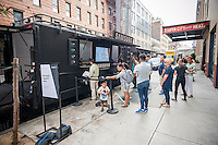 Samsung owners on line for service at a pop-up trailer for Fashion Week outside the Samsung 837 showroom in the Meatpacking District in New York on Friday, September 9, 2016. The batteries in Samsung Electronics' Galaxy Note 7 smartphones apparently can catch fire while charging precipitating a ban on charging them on several airlines and an obligatory recall. (© Richard B. Levine)