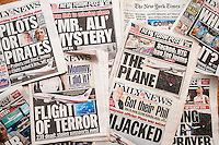 New York City newspapers over several days report on the disappearance of Malaysian Flight 370 on March 8, 2014. (© Ricard B. Levine)