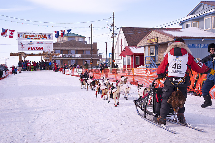 Musher rookie Ryne Olson arrives at the finish line in Nome, Alaska during Iditarod Dogsled Race, 2012