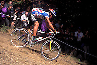Thomas Frischknecht riding down the Pipeline at Grundig World Cup XC race , 1995<br /> Plymouth , Devon <br /> pic copyright Steve Behr / Stockfile