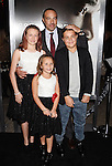 WESTWOOD, CA - NOVEMBER 23: Director/writer Peter Landesman (C) and family attend the screening of Columbia Pictures' 'Concussion' at the Regency Village Theater on November 23, 2015 in Westwood, California.