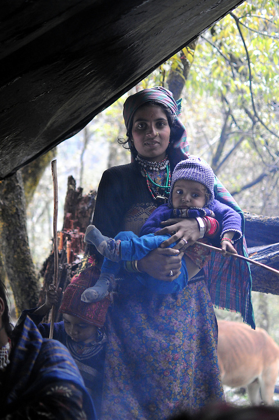 Akloo holds Hasina at a camp 10,000 feet above sea level.