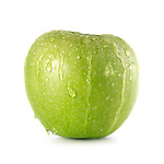 Green Granny Smith apple with water droplets running over it Isolated on white background