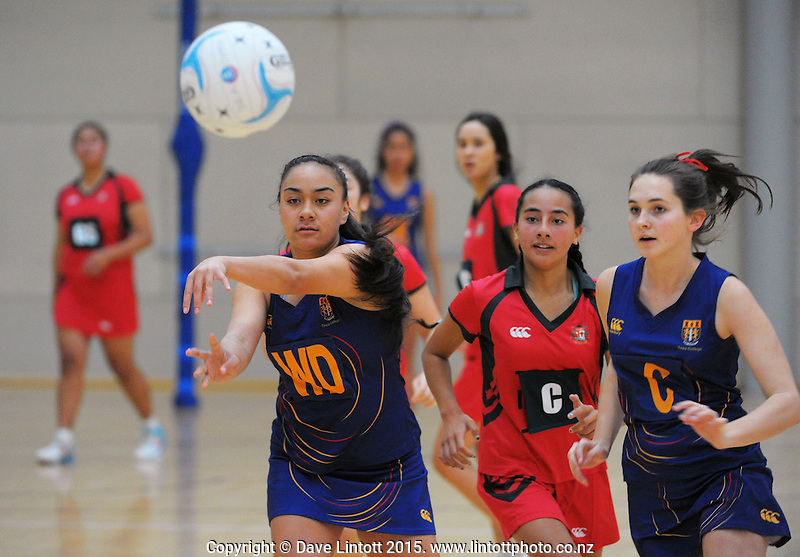 Action from the match between Tawa College (navy and yellow) and Bishop Viard (red) during the 2015 College Sport Wellington senior Netball Tournament at ASB Sports Centre, Kilbirnie, Wellington, New Zealand on Thursday, 21 May 2015. Photo: Dave Lintott / lintottphoto.co.nz
