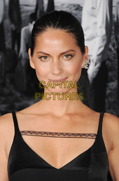 Olivia Munn<br /> arriving at the Los Angeles Season 2 Premiere Of HBO's Series 'The Newsroom' at Paramount Pictures Studios in Hollywood, California, USA, July 10th 2013.<br /> portrait headshot black lace dress sleeveless straps earring silver <br /> CAP/ROT/TM<br /> &copy;Tony Michaels/Roth Stock/Capital Pictures