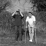 "Paul Jones ( on crutches) and Ron Davies, at RAF Fairford on the day of the outbreak of the second  Gulf War 19/3/03.  ..Both factory workers from Stroud  who have come to have  a look around. They often go to airshows at the weekend...When asked about the war they both said .""Get on with it"" ......."