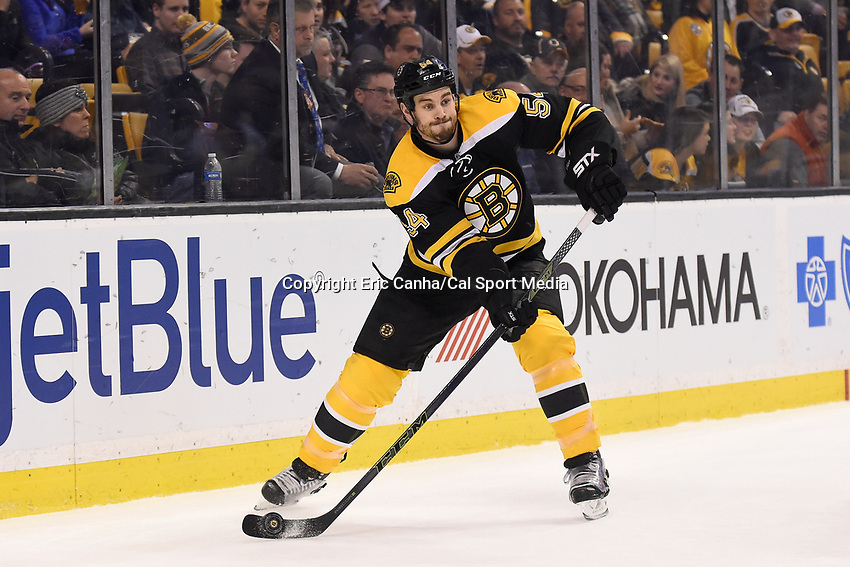 Tuesday March 1, 2016: Boston Bruins defenseman Adam McQuaid (54) in game action during the National Hockey League game between the Calgary Flames and the Boston Bruins, held at TD Garden, in Boston, Massachusetts. Boston defeats Calgary 2-1 in regulation time. Eric Canha/CMS