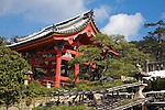 Kyoto City,  Japan<br /> Kiyomizu Temple, stone lanterns with temple bell tower in the background