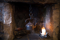 Traditional fireplace with old kettle at the world renowned gastronomic five star restaurant The Three Chimneys on the Isle of Skye in Scotland