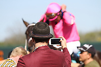 HOT SPRINGS, AR - March 18: Fans take photos of winning jockey Gary Stevens after the sixth race at Oaklawn Park on March 18, 2017 in Hot Springs, AR. (Photo by Ciara Bowen/Eclipse Sportswire/Getty Images)