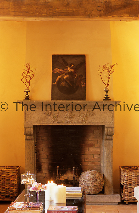 A 'chiaro scuro' Renaissance drawing rests above the stone mantelpiece of the fireplace
