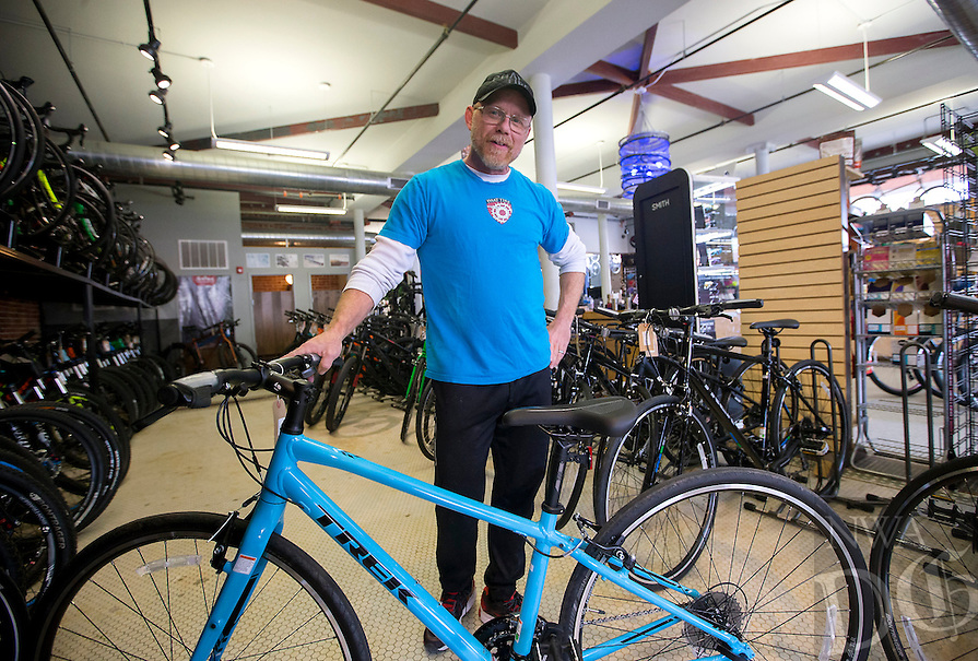NWA Democrat-Gazette/JASON IVESTER<br /> Brian Camp details a hybrid bicyle on Wednesday, Feb. 8, 2017, at Phat Tire Bike Shop in Bentonville.