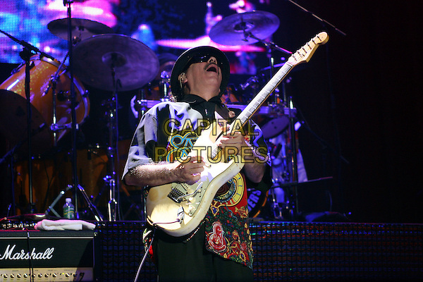 SANTANA.Performs in concert at Madison Square Garden in New York City..June 15th, 2005.stage live concert music gig performance half length guitar hat sunglasses shades .www.capitalpictures.com.sales@capitalpictures.com.©Capital Pictures