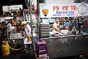 A stall owner prepares Char Koay Teow, a dish Penang is famous for  at a Chinese Hawker stall in the UNESCO heritage city of Georgetown in Penang, Malaysia. Photo: Sanjit Das/Panos