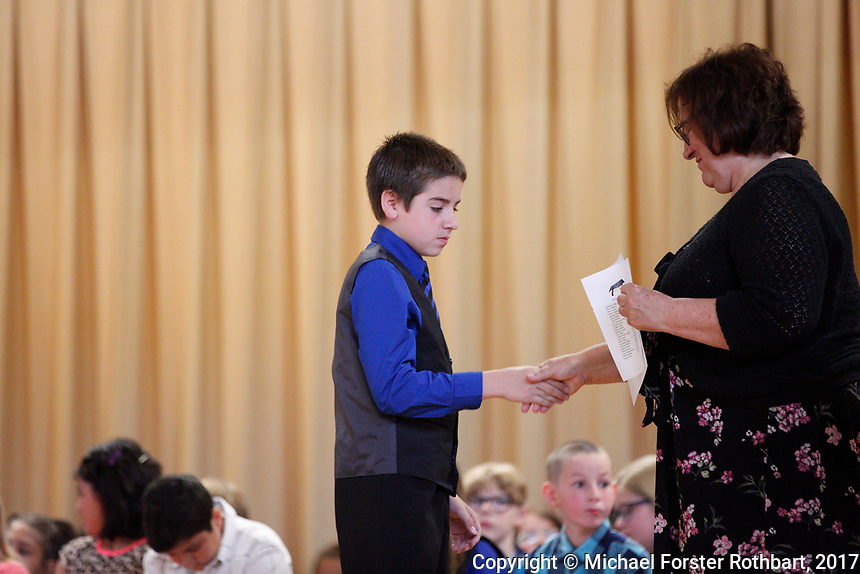 The Oneonta Greater Plains elementary school fifth grade awards ceremony, on June 21, 2017.<br /> &copy; Michael Forster Rothbart Photography<br /> www.mfrphoto.org &bull; 607-267-4893<br /> 34 Spruce St, Oneonta, NY 13820<br /> 86 Three Mile Pond Rd, Vassalboro, ME 04989<br /> info@mfrphoto.org<br /> Photo by: Michael Forster Rothbart<br /> Date:  6/21/2017<br /> File#:  Canon &mdash; Canon EOS 5D Mark III digital camera frame C19235