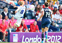 July 25, 2012..Sonia Bompastor (8) and Abby Wambach (14). USA vs France Football match during 2012 Olympic Games at Hampden Park in Glasgow, England. USA defeat France 4-2 after conceding two goals in the first half of the match...(Credit Image: © Mo Khursheed/TFV Media)