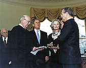Judge Larry Silverman swears Donald H. Rumsfeld, right, into office as the 21st United States Secretary of Defense during a White House Oval Office ceremony on January 26, 2001.  Observing the proceedings are US Vice President Richard B. Cheney, far left, US President George W. Bush, and Rumsfeld's wife Joyce, holding the bible.<br /> Mandatory Credit: Robert D. Ward / DoD via CNP