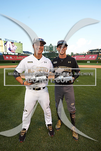 Andy Yerzy (15) of York Mills Collegiate Institute in Toronto, Ontario and Carter Kieboom (22) of Walton High School in Marietta, Georgia during the Under Armour All-American Game on August 15, 2015 at Wrigley Field in Chicago, Illinois. (Mike Janes/Four Seam Images)