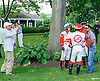Guy Smith discussing strategy with his team of jockeys while owner Joe Gillis takes a picture before The Delaware Park Arabian Oaks (grade II) at Delaware Park on 8/6/16