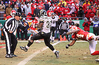 Jacksonville Jaguars running back Maurice Jones-Drew crosses the goal line for a touchdown leaving Jarrad Page grasping air during the fourth quarter at Arrowhead Stadium in Kansas City, Missouri on December 31, 2006. The Chiefs won 35-30.