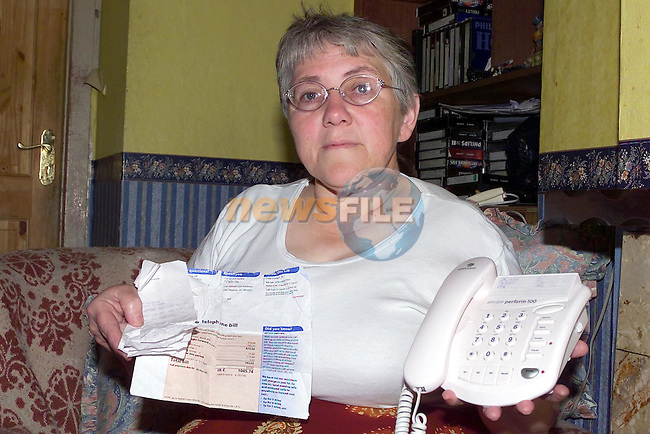 Elizabeth maguire from Slane in Co Meath with her telephone Bill from Eircom for over £1000 pounds..Picture Fran Caffrey Newsfile.
