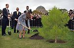 AUSTRALIA, Canberra : Britains Prince William (L) watches as Catherine, Duchess of Cambridge (R) plants an Aleppo Pine seedling derived from seeds gathered after the battle of Lone Pine at Gallipoli, Canberra on April 25, 2014. Britain's Prince William, his wife Kate and their son Prince George were on a three-week tour of New Zealand and Australia. AFP PHOTO / Mark GRAHAM