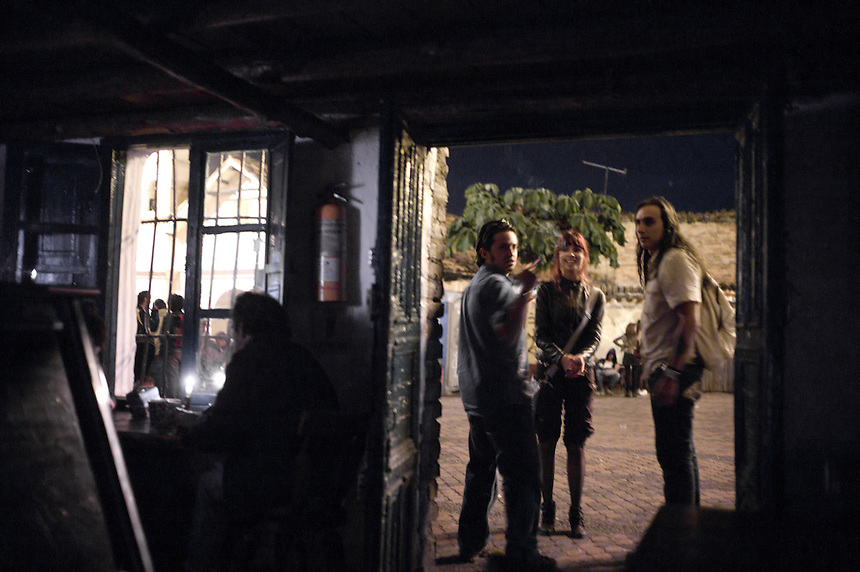 Students from some of the many universities and colleges gather in the Plazuela Chorro de Quevedo in Bogotá, Colombia for conversations, smokes and drinks at hip bars like the Pequeña Santafe, established ina  16th-century house on the small square in the Candelaria neighborhood.
