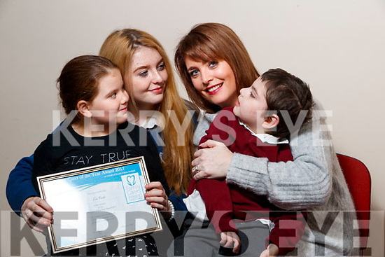 Liz Forde, Ardfert, who won the Carer of the Year Award pictured with her children, Gwen, Ellie, Liz, and Killian.