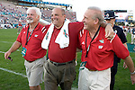 ORLANDO, FL - JANUARY 2:  Head coach Barry Alvarez, center, of the Wisconsin Badgers walks off the field with friends Ted Kellner, right, and Tony Canonie, left, after the game against the Auburn Tigers on January 2, 2006 at the Capital One Bowl in Orlando, Florida. The Badgers beat the Tigers 24-10. (Photo by David Stluka)