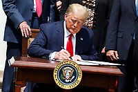 United States President Donald J. Trump signs H.R. 7010 - PPP Flexibility Act of 2020 in the Rose Garden of the White House in Washington, DC on June 5, 2020. <br /> Credit: Yuri Gripas / Pool via CNP/AdMedia