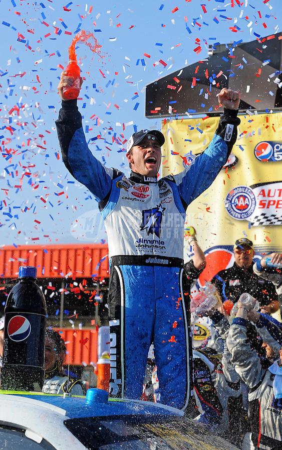 Oct. 11, 2009; Fontana, CA, USA; NASCAR Sprint Cup Series driver Jimmie Johnson celebrates after winning the Pepsi 500 at Auto Club Speedway. Mandatory Credit: Mark J. Rebilas-