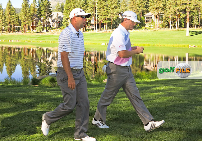 02 AUG 13  Josh Teater and Shaun Micheel walk down the 8th fairway together during Friday's Second Round action at The Reno Tahoe Open at The Montreux Country Club in Reno, Nevada.  (photo:  kenneth e.dennis / kendennisphoto.com)
