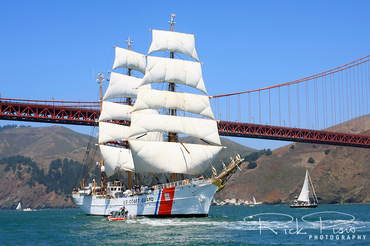"The USCG Training Barque ""Eagle,"" escorted by a Coast Guard Defender Class Response Boat, leads the Parade of Ships under the Golden Gate Bridge during the 2008 San Francisco Festival of Sail. The 295' Training Barque Eagle was originally constructed  in 1936 at the Blohm and Voss Shipyards in Germany with the purpose of training U-Boat crews. The United States took possession of the vessel in 1946 as part of Germany's reparations for the war and it is currently used by the Coast Gaurd for training of United States Coast Guard Academy Cadets. The Eagle is the only active commissioned sailing vessel in the United States' government service. Photographed 07/23/08"