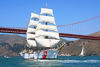 """The USCG Training Barque """"Eagle,"""" escorted by a Coast Guard Defender Class Response Boat, leads the Parade of Ships under the Golden Gate Bridge during the 2008 San Francisco Festival of Sail. The 295' Training Barque Eagle was originally constructed  in 1936 at the Blohm and Voss Shipyards in Germany with the purpose of training U-Boat crews. The United States took possession of the vessel in 1946 as part of Germany's reparations for the war and it is currently used by the Coast Gaurd for training of United States Coast Guard Academy Cadets. The Eagle is the only active commissioned sailing vessel in the United States' government service. Photographed 07/23/08"""