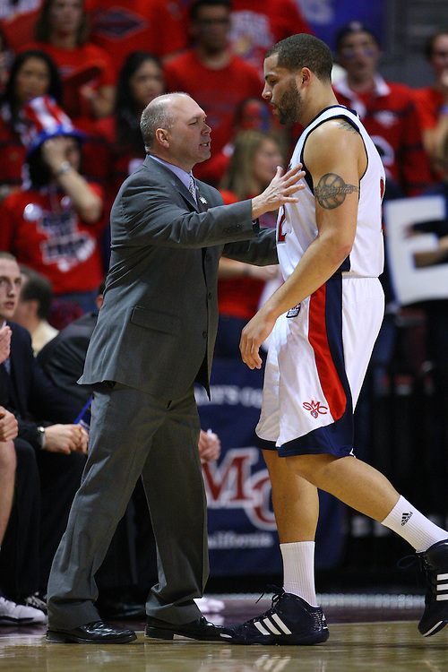 March 7, 2011; Las Vegas, NV, USA; Saint Mary's Gaels head coach Randy Bennett (left) instructs forward Rob Jones (right) against the Gonzaga Bulldogs during the WCC Basketball Championships at Orleans Arena. The Bulldogs defeated the Gaels 75-63.