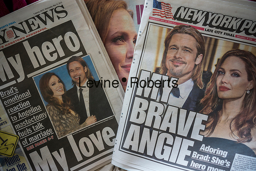 """Newspapers in in New York on Wednesday, May 15, 2013 report on Angelina Jolie's decision to have a double mastectomy to reduce her risk of getting breast cancer. Jolie inherited a """"faulty"""" BRCA1 gene and thus her chances of getting breast and ovarian cancers prompted her to prophylactically have her breasts removed. (© Richard B. Levine)"""