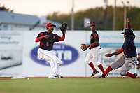 Batavia Muckdogs shortstop Marcos Rivera (8) catches a throw from catcher Alex Jones (not shown) on a stolen base attempt by Juan Barriento (right) who was tagged out on the play during a game against the Lowell Spinners on July 11, 2017 at Dwyer Stadium in Batavia, New York.  Second baseman Samuel Castro (5) is backing up the play.  Lowell defeated Batavia 5-2.  (Mike Janes/Four Seam Images)