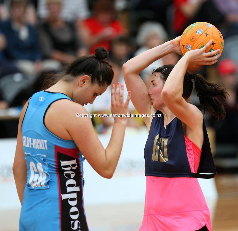 Legend's Jenny Ferguson looks to pass the ball over Steel's Te Paea Selby-Rickit in the Steel v Legends match, Edgar Centre, Dunedin, New Zealand, Saturday, March 16, 2013. Credit:NINZ/Dianne Manson