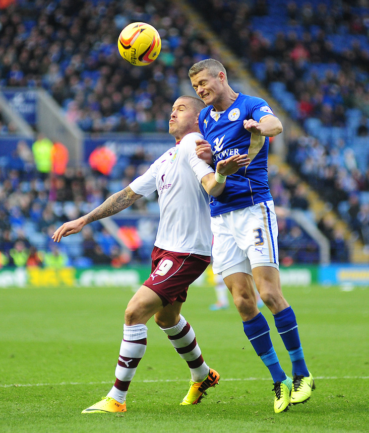 Leicester City's Paul Konchesky clears the ball under pressure from Burnley's Michael Kightly, who's appeals for a penalty were turned down<br /> <br /> Photo by Chris Vaughan/CameraSport<br /> <br /> Football - The Football League Sky Bet Championship - Leicester City v Burnley - Saturday 14th December 2013 - King Power Stadium - Leicester<br /> <br /> &copy; CameraSport - 43 Linden Ave. Countesthorpe. Leicester. England. LE8 5PG - Tel: +44 (0) 116 277 4147 - admin@camerasport.com - www.camerasport.com